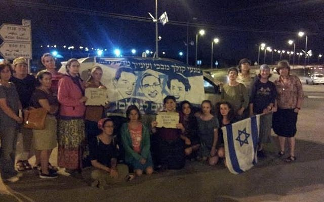 Women gather at the Gush Etzion Junction in song, solidarity and prayer for the release of the three Israeli teens abducted two weeks previously, Thursday, June 26, 2014. (photo credit: Yishai Hughes)