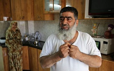 Omar Abu Aysha, father of suspected kidnapper Amer Abu Aysha, in his home in Hebron (photo credit: Courtesy)