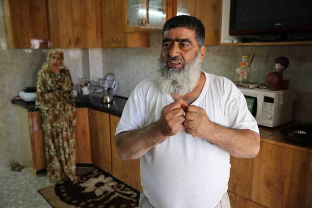 Omar Abu Aysha, father of suspected kidnapper Amer Abu Aysha, in his home in Hebron