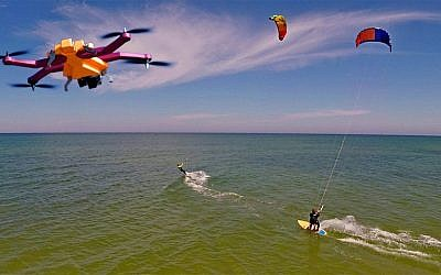 An AirDog (top left) follows some extreme windsurfers, taking video of the their stunts (Photo credit: Courtesy)