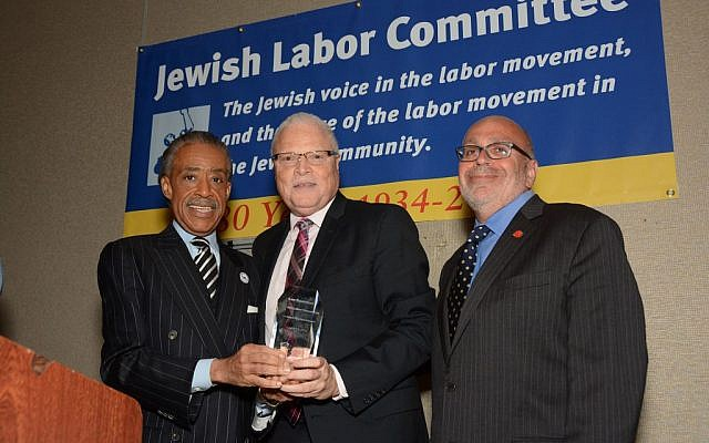 The Rev. Al Sharpton presented the Jewish Labor Committee's Human Rights Award to Lee Saunders (center), president of the American Federation of State, County and Municipal Employees, standing beside the JLC's president, Stuart Appelbaum (right), at the group's awards dinner in New York, June 19, 2014. (photo credit: Courtesy/Jewish Labor Committee)