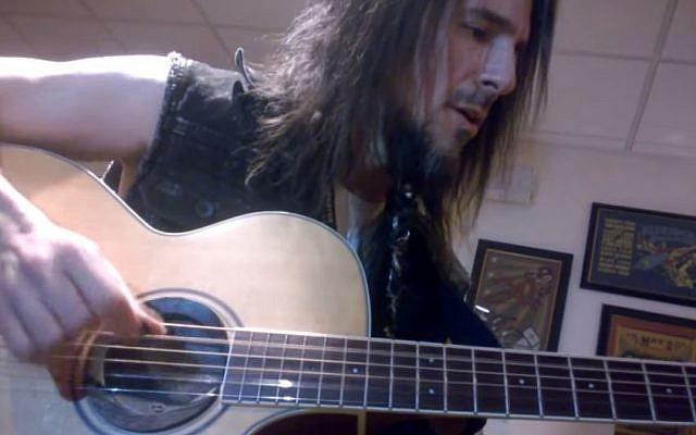 Guns N' Roses lead guitarist Ron 'Bumblefoot' Thal plays the Israeli national anthem, 'Hatikva,' backstage before a concert in Las Vegas in June 2014. (screen capture, YouTube)