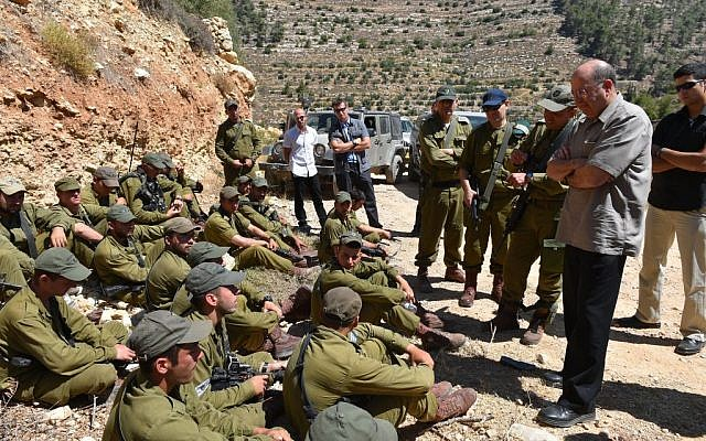 Moshe Ya'alon in the Hebron region with troops from the Kfir Brigade on Monday. (photo credit: Ariel Hermoni/ Ministry of Defense)