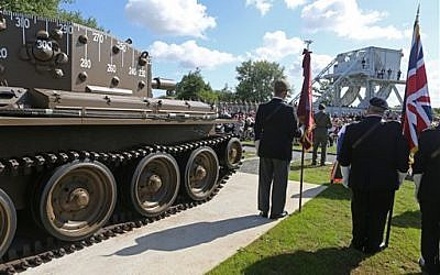 A remembrance ceremony is held at Pegasus Bridge memorial in Benouville western France, Thursday June 5, 2014, as part of the commemoration of the 70th anniversary of the D Day. (photo credit: AP Photo/Remy de la Mauviniere)