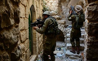 Illustrative photo of Israeli soldiers in the West Bank city of Hebron. (photo credit: IDF Spokesperson/FLASH90)