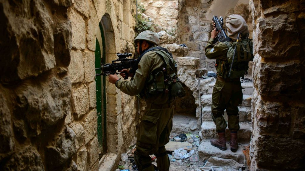 Israeli soldiers in the West Bank city of Hebron during search efforts for three Jewish teenagers on June 14, 2014. (photo credit: IDF Spokesperson/FLASH90)