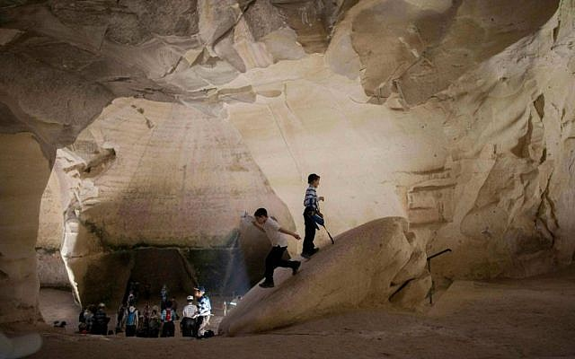 Tourists visiting ancient caves in Israel. (Yonatan Sindel/Flash90)