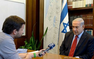 Prime Minister Benjamin Netanyahu being interviewed by foreign press, at the Prime Minister's Office in Jerusalem on June 29, 2014. (photo credit: Haim Zach/GPO/FLASH90)