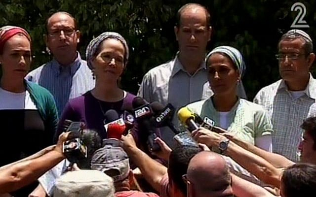 Racheli Sprecher Frankel, mother of kidnapped Israeli youth Naftali, speaks to the press outside her house on Tuesday, June 16, 2014. She is flanked by the parents of two other teens kidnapped with her son, Gil-ad Shaar and Eyal Yifrach. (screen capture: Channel 2)