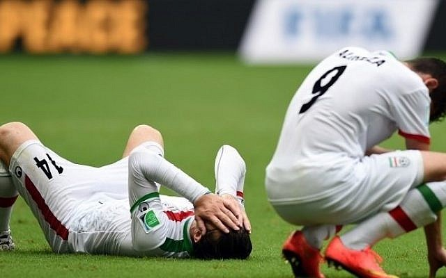 Iran's midfielder Andranik Teymourian (L) and Iran's forward Alireza Jahanbakhsh react after their team lost a Group F football match between Bosnia-Hercegovina and Iran at the Fonte Nova Arena in Salvador during the 2014 FIFA World Cup on June 25, 2014. Bosnia-Hercegovina won 3-1. (photo credit: AFP PHOTO / JAVIER SORIANO)
