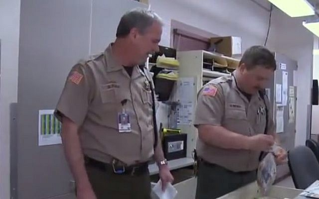 Illustrative photo of employees at the Clackamas County Jail, Oregon. (photo credit: Youtube screenshot)
