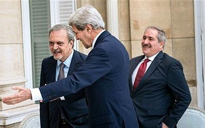 Jordanian Foreign Minister Nasser Judeh, right, US Secretary of State John Kerry, center, and Saudi Arabia's Foreign Minister Prince Saud al-Faisal walk to a meeting at the US Chief of Mission Residence in Paris, France, June 26, 2014 (photo credit: AP/Brendan Smialowski, pool)