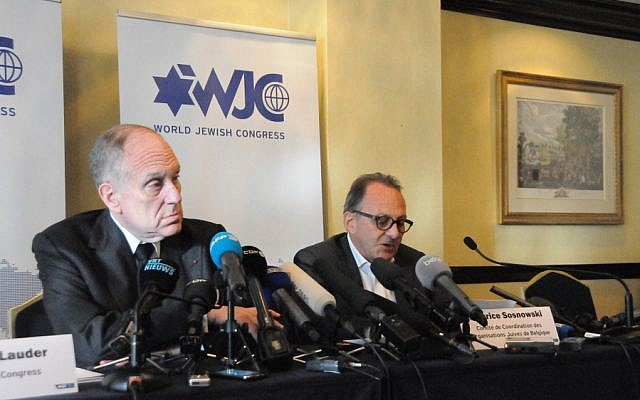 WJC president Ronald Lauder (left) and Maurice Sosnowski, president of the Belgian Jewish umbrella organization CCOJB, attend a press conference on Monday, June 2, 2014 (photo credit: Surya Jonckheere/Times of Israel)