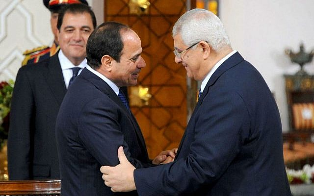 "Egyptian President Abdel-Fattah el-Sissi, left, and interim President Adly Mansour shake hands after signing a ""handover of power document,"" transferring the presidency to el-Sissi, June 8, 2014. (photo credit:AP /MENA)"