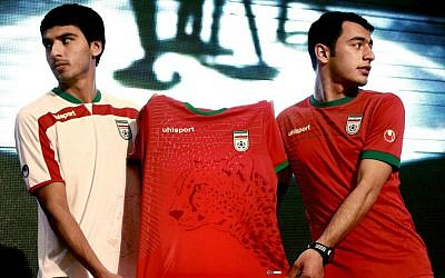 Iranian soccer players Mohammad Reza Bazaj, right, and Meysam Joudaki present the Iranian national soccer team's newly designed t-shirt with an imprint of the endangered Asiatic Cheetah. (photo credit: AP Photo/Vahid Salemi/Ebrahim Noroozi)
