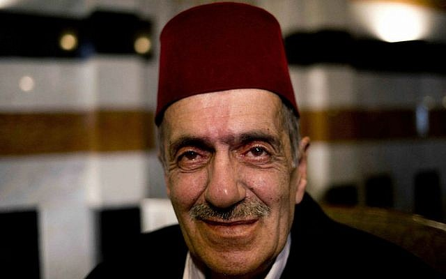 """Rashid Hallak, a former professional storyteller, poses for a portrait in Damascus, Syria. For more than 20 years, the Storyteller of Damascus entertained crowds in a centuries-old cafe in the Syrian capital with long, poetic tales. Hallak was the most famous of the few remaining """"hakawatis"""" in Syria. (AP Photo/Dusan Vranic)"""