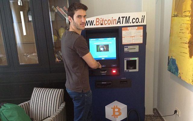 Nimrod Gruber uses Israel's first Bitcoin ATM in Tel Aviv, June 12, 2014. (Photo credit: Ben Sales/JTA)