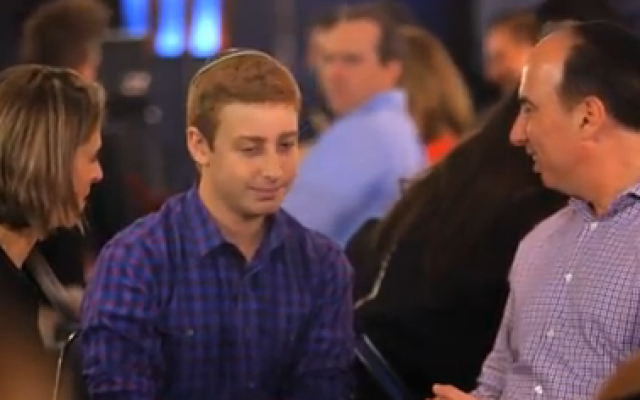 Josh Orlian (center) sits with his parents before taking the stage on 'America's Got Talent,' June 17, 2014. (screen capture: YouTube/America's Got Talent)