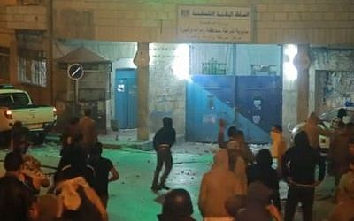 Palestinian youths attackinga PA polices station in Ramallah, early morning Sunday, June 22 2014. (photo credit: YouTube image capture)