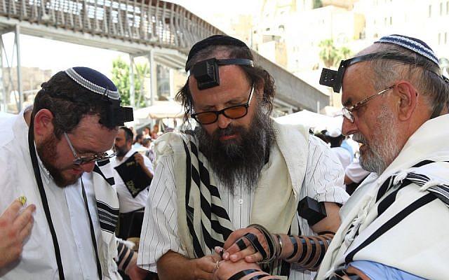 Rabbi Boaz Pash, center, at the bar mitzvah in Jerusalem of Mariusz Robert Aoflko, right, a 65-year old Jewish man from Krakow, in 2013. (Sasson Tiram/Shavei Israel/via JTA)