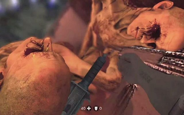 In this gruesome moment from 'Wolfenstein: The New Order,' you must peel dead bodies off of you and crawl out of an oven before you are killed. (Courtesy: Bethesda Softworks)