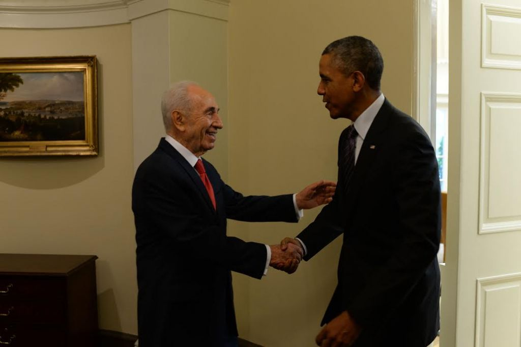 President Barack Obama greets President Shimon Peres at the White House on June 25 (photo credit: Kobi Gidon/GPO)