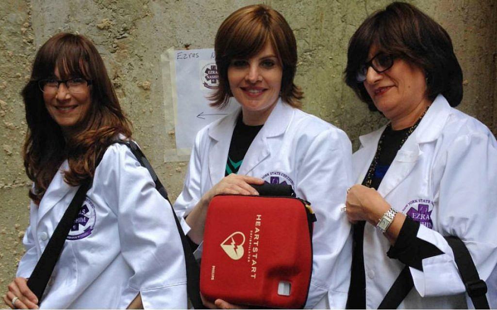 Ezras Nashim volunteers Fraidy Liberow, Yitty Mandel and Sarah Gluck (courtesy)