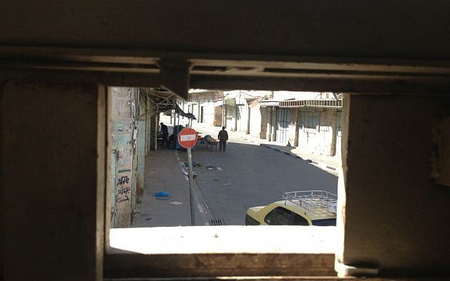 The view into the Palestinian streets of Hebron from the lookout post outside the yeshiva photo credit: Mitch Ginsburg/ Times of Israel)