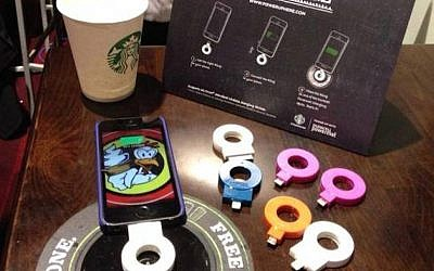 A cellphone recharging on a Powermat Spot at a California Starbucks (Photo credit: Courtesy)