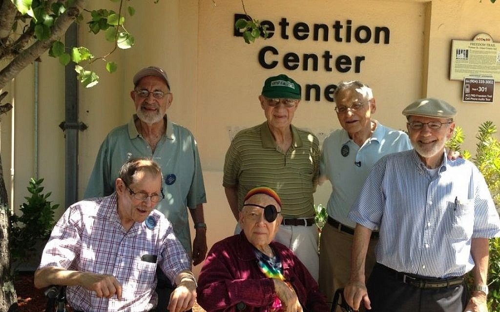 Six Reform rabbis pose outside the jail in St. Augustine, Florida, where they spent a night after being arrested protesting for civil rights 50 years earlier. Standing (from left to right), are Allen Secher, Israel Dresner, Jerrold Goldstein and Richard Levy. Sitting are Daniel Fogel, left, and Hanan Sills. (photo credit: Dina Weinstein/JTA)