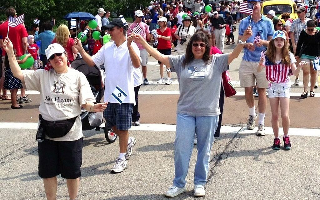 Members of the Aitz Hayim Center for Jewish Living in Glencoe, Ill., show U.S. and Israeli colors at the 2012 Fourth of July parade in nearby Highland Park. (Todd Jacobs/JTA)