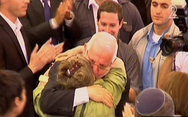 Reuven Rivlin hugging his wife after winning the presidency Tuesday. (Screen capture: Channel 2)