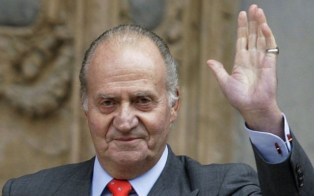 Spanish King Juan Carlos, waves after attending an Easter Mass in 2009. Spanish Prime Minister Mariano Rajoy said Carlos plans to abdicate and pave the way for his son, Monday June 2, 2014 (photo credit: AP/Manu Mielniezuk)
