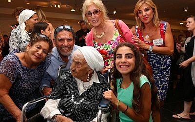 Talia Byrnes, bottom right, poses with her great-grandmother and other family members. (photo credit: Photo by Nir Shaanani)