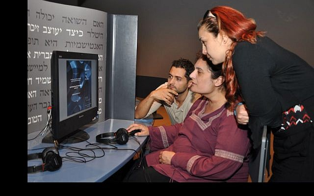 Members of a Turkish delegation explore the Learning Center: Reflection After the Holocaust, at Yad Vashem (photo credit: : Martin Sykes-Haas)