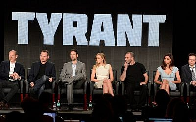 "From left, executive producers Howard Gordon and Gideon Raff and cast members Adam Rayner, Jennifer Finnigan, Ashraf Barhom, Moran Atias and Justin Kirk participate in the ""Tyrant"" panel at the FX Winter TCA Press Tour, on Tuesday, January 14, 2014 at the Langham Huntington, in Pasadena, Calif. (Photo by Phil McCarten/Invision for FOX/AP Images)"