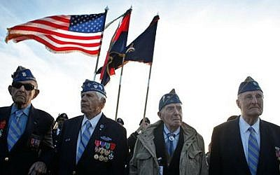 Illustrative:  World War II veterans of the US 29th Infantry Division (from left) Hal Baumgarten, 90, from Pennsylvania, Steve Melnikoff, 94, from Maryland, Don McCarthy, 90, from Rhode Island, and Morley Piper, 90, from Massachusetts, attend a D-Day commemoration on Omaha Beach, western France, Friday June 6, 2014. (AP/Thibault Camus)