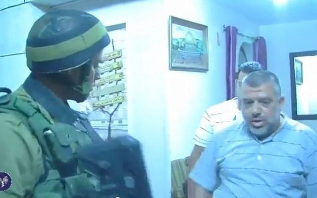 Hamas officialHassan Yousef is arrested by IDF troops following the abduction of three Israeli teenagers, June 15,2014 (screen capture: YouTube)