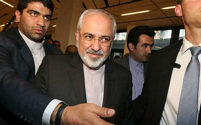 Iranian Foreign Minister Mohammad Javad Zarif, center, arrives for a press briefing for Iranian journalists after the closed-door nuclear talks at the International Center, in Vienna, Austria, Friday, June 20, 2014 (photo credit: AP/Ronald Zak)