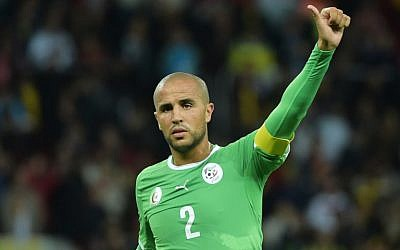 Algeria captain Madjid Bougherra gestures during a World Cup game, June 30, 2014 (photo credit: AFP/GABRIEL BOUYS)