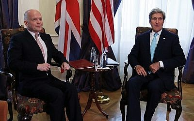 British Foreign Secretary William Hague talks with US Secretary of State John Kerry during a bilateral meeting during talks between the foreign ministers of the six powers negotiating with Tehran on its nuclear program, in Vienna, on July 13, 2014. (Photo credit: Jim Bourg/Pool/AFP)