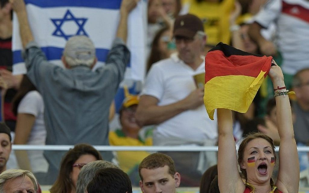 A fan of Germany cheers before the 2014 FIFA World Cup final football match between Germany and Argentina at the Maracana Stadium in Rio de Janeiro on July 13, 2014. (AFP PHOTO / JUAN MABROMATA)
