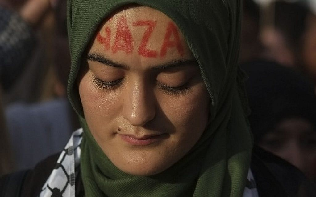 "A protester with ""Gaza"" written on her forehead looks down during a demonstration against Israeli air strikes on Gaza, in Madrid on July 17, 2014. (Photo credit: AFP/Pedro Armestre)"