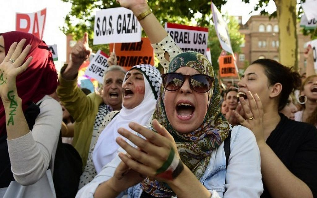 Protesters shout slogans and gesture during a demonstration against Israel's Operation Protective Edge outside the Israeli Embassy in Madrid, Thursday, July 24, 2014. (photo credit: Javier Soriano/AFP)