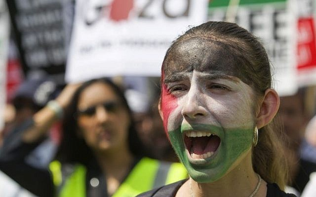 A demonstrator with a painted face marches through the streets from outside the Israeli embassy in central London on July 26, 2014 (Photo credit: Justin Tallis/AFP)
