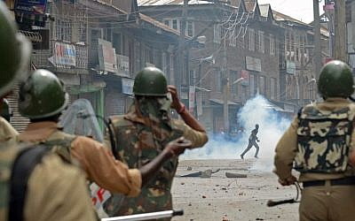 Kashmiri demonstrators clash with Indian police during a demonstration against Israeli military operations in Gaza, in downtown Srinagar on July 18, 2014. (photo credit: AFP/Tauseef Mustafa)