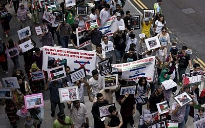 People march in Hong Kong to protest against Israel's military campaign in Gaza on July 13, 2014.  (photo credit: AFP/ALEX OGLE)