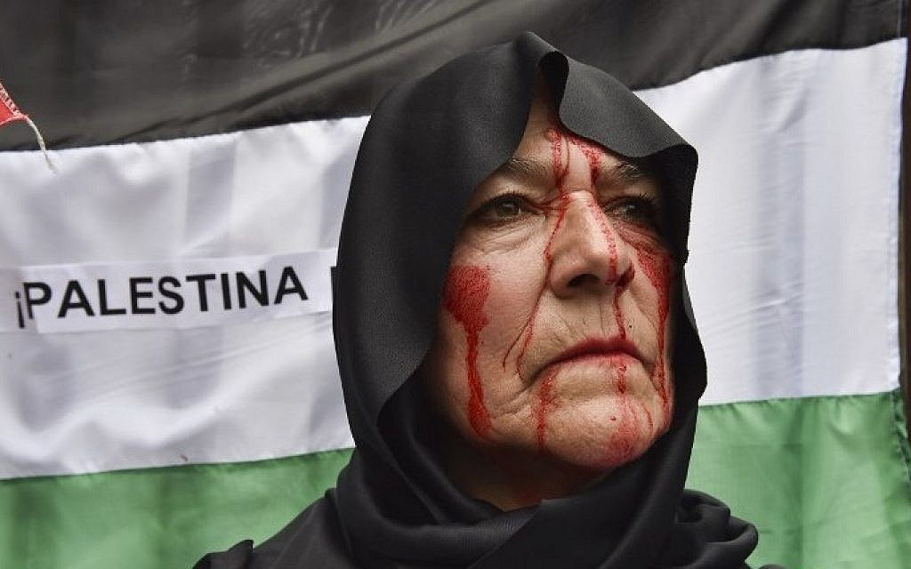 A pro-Palestinian activist participates in a rally against the Israeli military offensive in the Gaza Strip outside the Mexican Foreign Ministry building in Mexico City on July 11, 2014 (Photo credit: Yuri Cortez/AFP)