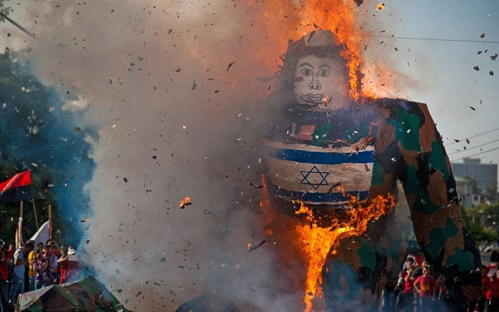 Salvadorean students burn a dummy with Israel's national flag as they protest against Israel's military action in the Gaza strip on July 30, 2014. (photo credit:AFP/ Jose Cabezas)