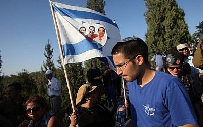 Tens of thousands Israelis attend the joint funeral of Gilad Shaar, 16, Naftali Fraenkel, 16, and Eyal Yifrach, 19, in the central Israeli town of Modiin on July 1, 2014. (photo credit: AFP/GIL COHEN MAGEN)